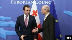 Georgian Prime Minister Irakli Garibashvili (left) with EU Council President Herman Van Rompuy in Brussels on February 4.