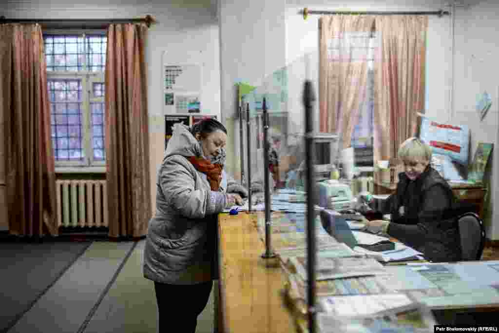 Lidia Dmitrievna Sholicheva visits the local post office, which once employed 13 people