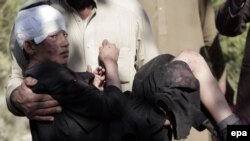 An Afghan boy who was injured in a bomb blast is brought to a hospital in Nangarhar, Afghanistan, in November. The UN says there has been an upsurge in the number of civilians affected by violence in the country.