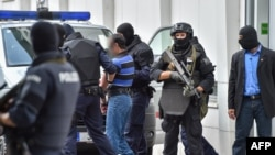 A suspected member of the Islamic State jihadist group is led away by Austrian police from the court in Linz in July 27.