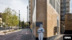 "A photo showing empty Tehran streets with someone holding a sign saying ""Let's not be afraid"". March 23, 2020"