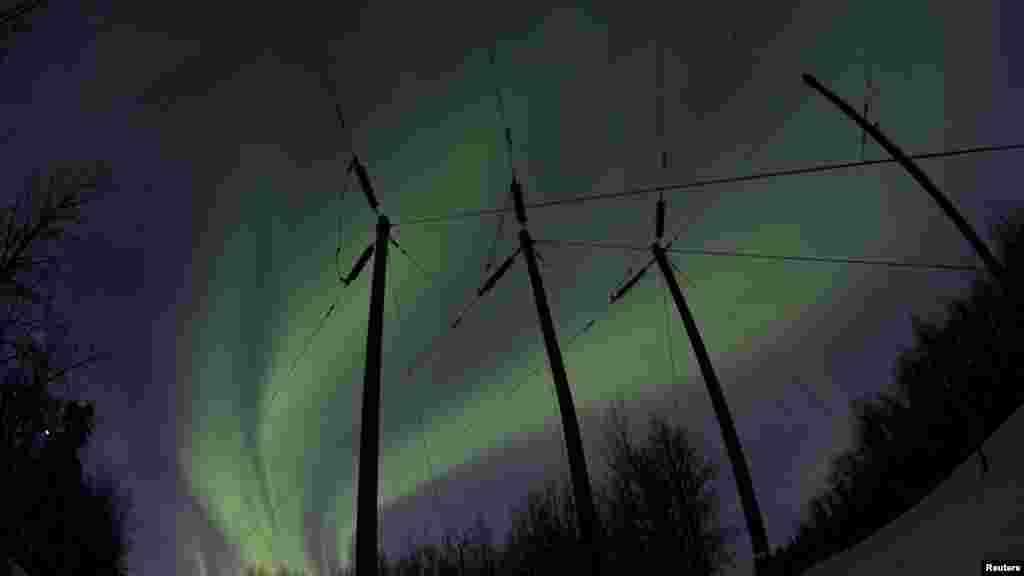 Aurora borealis lights dance over power lines at mile 9 on the Old Glenn Highway near Butte, Alaska. (Reuters/Oscar Edwin Avellaneda)