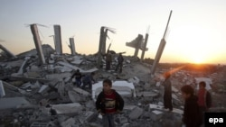 Palestinian boys play where a house once stood in east Gaza City.