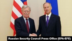 U.S. national-security adviser John Bolton (left) shakes hands with Russian Security Council Secretary Nikolai Patrushev during a meeting in Moscow on October 22.