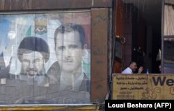 "Совместное изображение Башара Асада и лидера ""Хизбаллы"" Хасана Насраллы на плакате в Дамаске"