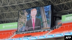 A speech by FC Shakhtar president Rinat Ahkhmetov is broadcast on a giant screen during a peace rally held at the Donbass Arena in the eastern Ukrainian city of Donetsk on May 20.