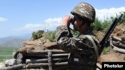 Armenia - An Armenian soldier stands guard on the border with Azerbaijan's Nakhichevan exclave, 14 May 2016.