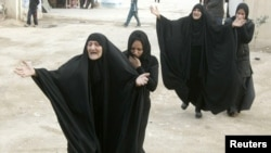 Women mourn during a funeral for a victim who was killed in one of the December 22 bomb attacks.