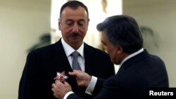 Turkey -- Azerbaijan's President Ilham Aliyev receives Turkey's State Honor Medal from his Turkish counterpart Abdullah Gul (R) during a ceremony at the Presidential Palace in Ankara, November 12, 2013