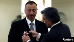 Azerbaijani President Ilham Aliyev received Turkey's State Honor Medal from Turkish President Abdullah Gul during a ceremony at the Presidential Palace in Ankara on November 12.
