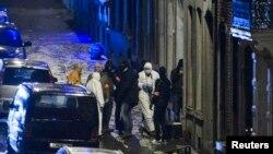 Бельгия полиция проводит обыск в Вервье, 15 января 2015 года.