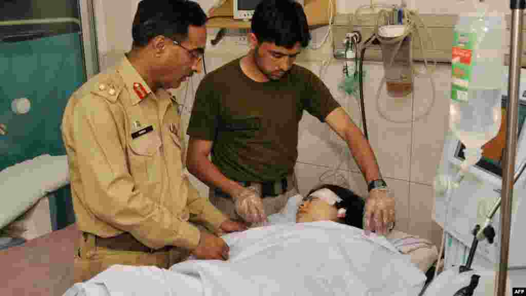 Army doctors treat Malala at a military hospital, where she underwent surgery to remove a bullet.