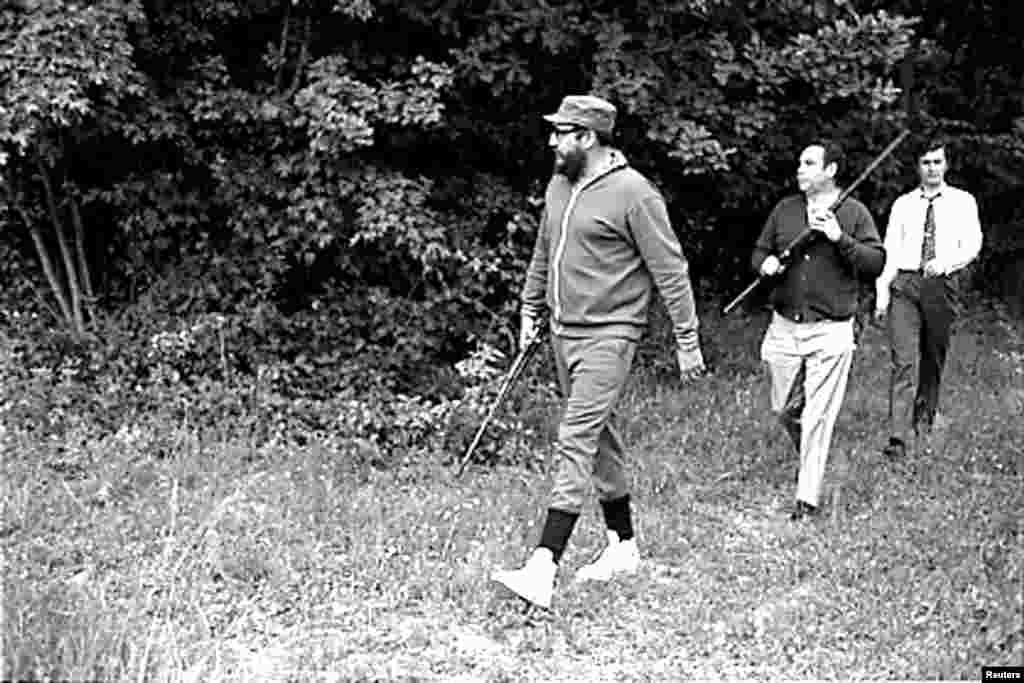 Castro (front) managed a spot of hunting while on a visit to Romania in May 1972 when the country was ruled by communist dictator Nicolae Ceausescu.