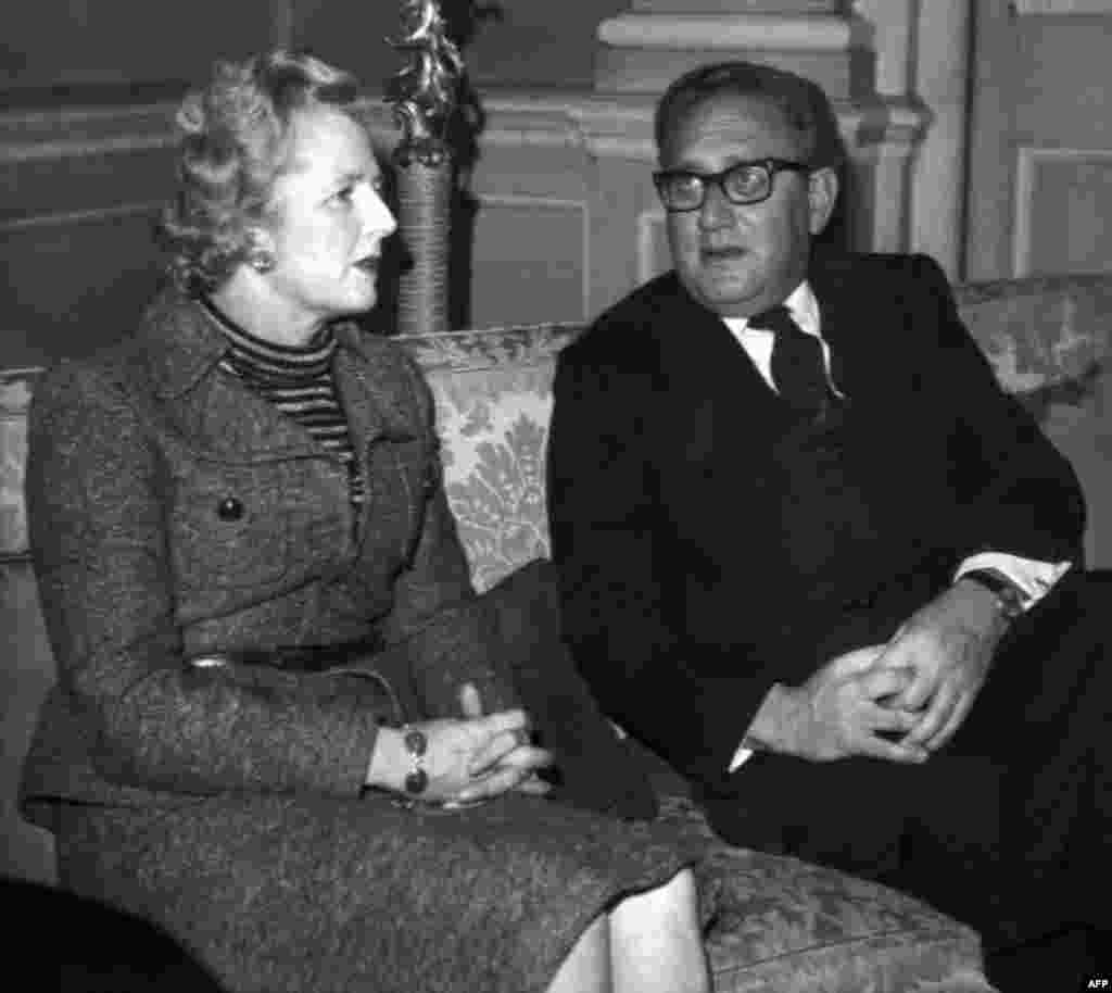 U.S. Secretary of State Henry Kissinger (right) meets with Margaret Thatcher in London in February 1975.