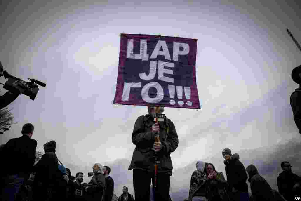 Demonstrators march during a protest against the presidential election victory of Serbian Prime Minister Aleksandar Vucic in Belgrade on April 18. (AFP/Oliver Bunic)