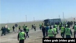 Videos and photos that circulated on social media showed hundreds of workers in hard hats and uniforms massing at a site near the Tengiz oil field.