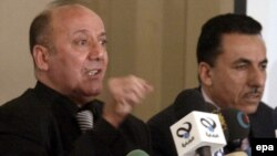 Iraq -- Faraj al-Haydari, chairman of Iraq's independent election commission (L), speaks during a news conference in Baghdad, 17Feb2009
