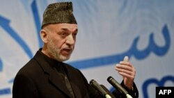 Afghan President Hamid Karzai has used civilian deaths and errant air strikes to launch bitter criticism of the international military effort in Afghanistan.