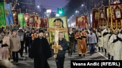 People gather at the invitation of the Serbian Orthodox Church to walk through the center of Belgrade on January 8.