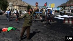 An Afghan man gesticulates near the scene of a deadly suicide attack that targeted crowds of minority Shi'ite Hazaras during a demonstration in Kabul on July 23.