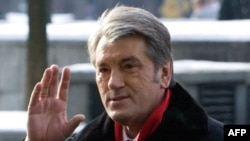 President Viktor Yushchenko waves as he greets people after casting his ballot at a polling station in Kyiv.