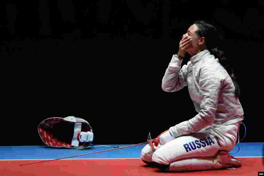 Yana Yegoryan of Russia reacts after beating Sofia Velikaya, also of Russia, in the women's individual saber event.