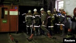Coal miners enter the shaft at the Kostenko mine in Qaraghandy.