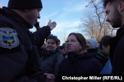 Ukrainian police move on transgender rights activists after their rally in a Kyiv park was disrupted by far-right radicals on November 18.