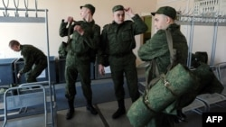Russian Army conscripts put on their uniform at the military registration and enlistment office in St. Petersburg in April.