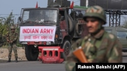 An Indian Army soldier stands guard during a curfew in Jammu.