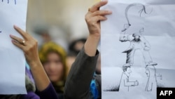 На акции протеста против насилия в семье. Кабул, 24 сентября 2012 года.