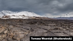 A lava flow from Kamchatka's Tobalchik Volcano, which last erupted in 1975, with the newly active Bolshaya Udina Volcano (right).