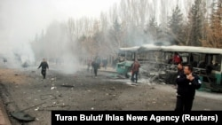 The scene in Kayseri where a bus was hit by an explosion.
