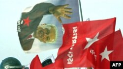 Supporters of the Ergenekon network display Workers' Party flags in Istanbul