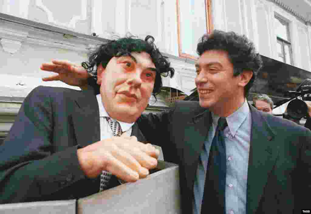 Nemtsov became leader of the Union of Right Forces party. Here he is seen with an effigy of himself from the political satire show, Puppets, in 1999.