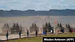 Russian, Chinese, and Mongolian troops and military equipment parade at the end of the day of the Vostok-2018 military drills not far from the Chinese-Mongolian border in Siberia in September 2018.