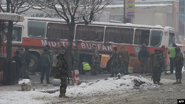Afghan National Army soldiers investigate the scene following a suicide attack targeting a bus carrying Afghan army personnel in Kabul on February 27.