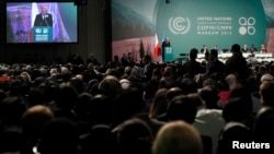 Delegates take part in the opening ceremony of the 19th conference of the United Nations Framework Convention on Climate Change at the National Stadium in Warsaw on November 11.