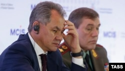 Russian Defense Minister Sergei Shoigu (left) and armed forces Chief of Staff Valery Gerasimov attend a security conference in Moscow in April 2015.