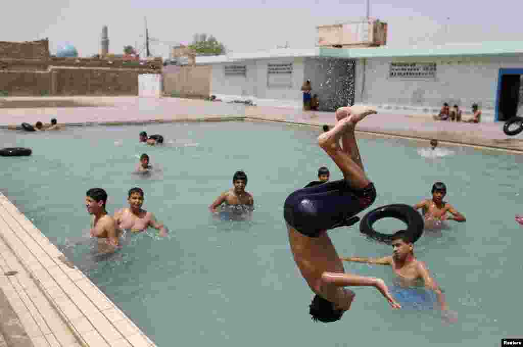 Youths play at a swimming pool in Sadr City.