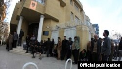 Iranian waiting outside the Iraqi Consulate in Mashhad to obtain visas. Undated