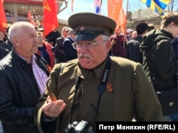 Some 200 people attended the unveiling, many carrying Stalin portraits and Soviet symbols.