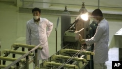 Iranian technicians at work in a uranium fuel-production facility