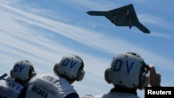 An X-47B pilotless drone combat aircraft -- as big as a fighter jet -- is launched for the first time off an aircraft carrier in the Atlantic Ocean off the coast of Virginia on May 14.