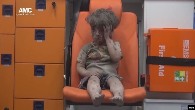 Omar Daqneesh sits bloodied in an ambulance after an air strike in Aleppo.