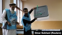Afghan election commission workers prepare ballot papers for counting after the September 28 voting..