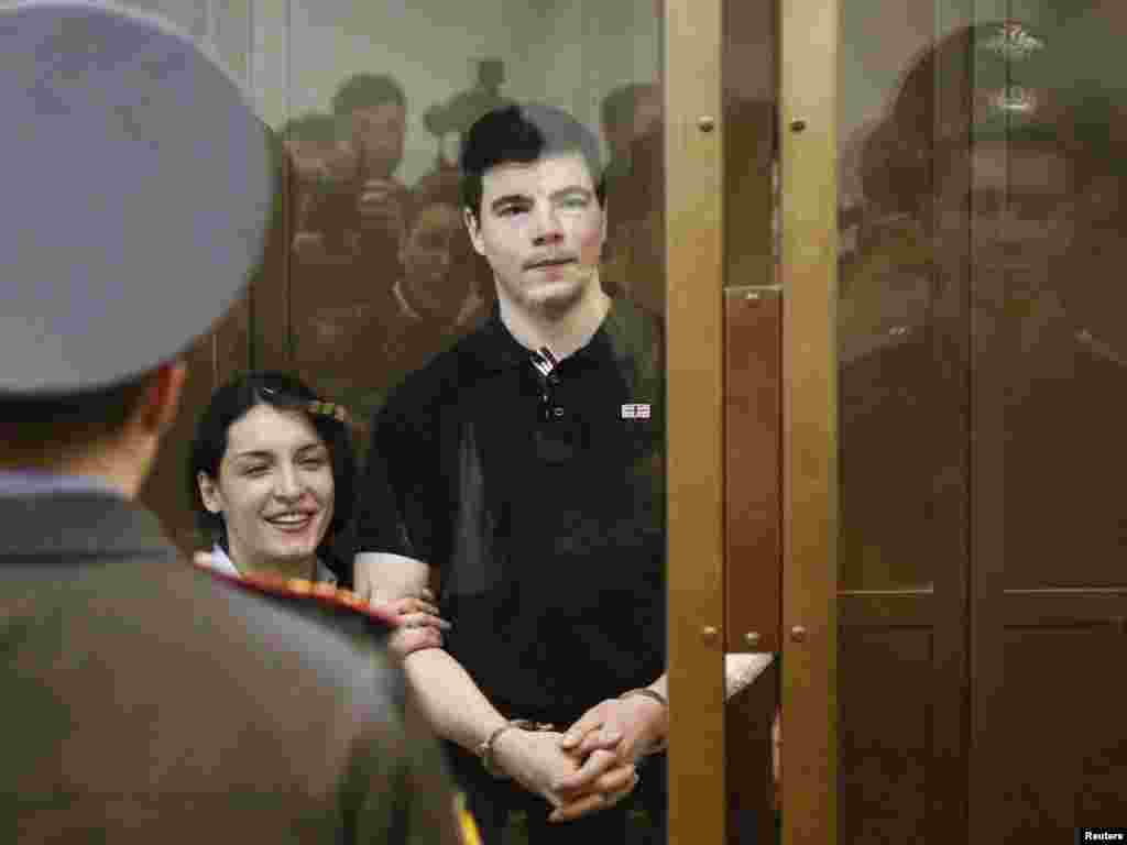 Nikita Tikhonov (right) and Yevgenia Khasis listen to their sentences in a Moscow courtroom on May 6. The court sentenced Khasis to 18 years in prison and Tikhonov to life for the killing of lawyer Stanislav Markelov and journalist Anastasia Baburova Photo by Mikhail Voskresensky for Reuters.