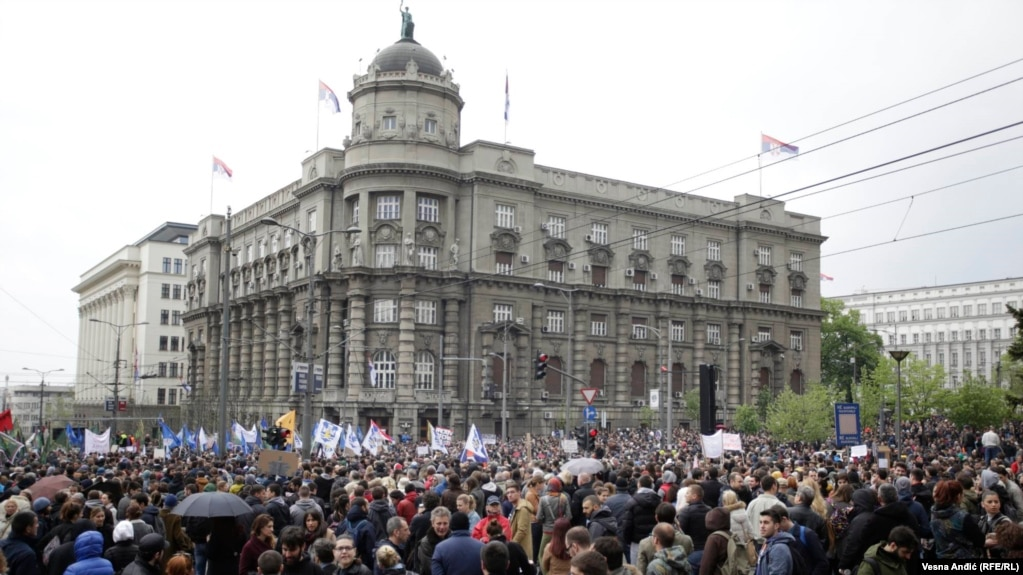 The demonstrators in the Serbian capital joined hundreds of policemen and soldiers who were holding a separate rally over low wages and poor living standards.