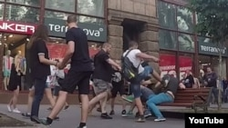A video experiment in which a gay couple strolled around Kyiv hand-in-hand to gauge homophobic sentiment went largely without incident until they were attacked by a group of men.