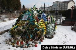 The grave of 27-year-old Ukrainian Army soldier Taras Dorosh in Malekhiv, his home village in the Lviv region. Dorosh died far from home after being shot by a sniper during heavy fighting against pro-Russian forces in eastern Ukraine.